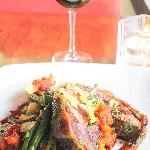 Lamb with garlic chips, seasonal vegetables and red-wine sauce