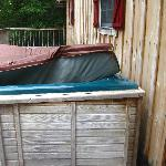 Broken hot tub on the deck.
