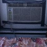 Dusty a/c unit by bed