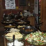 The main buffet with salads and skillets with fish