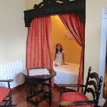 """Our daughter's """"Princess Bed"""" - can also be sitting area -- in our king room."""