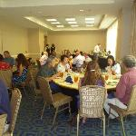 Feasting at luncheon celebration the following day