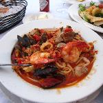 Seafood pasta had lots of shrimp (ate some already from the picture)