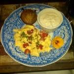Egg Scramble with cherry tomatoes and basil with muffin and grits