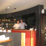 The maitre d' and the barman at the gleaming bar