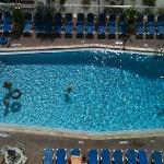 view from balcony overlooking main pool beachfront
