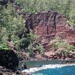 Red sand beach from a distance
