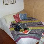 our bed with all our stuff on it