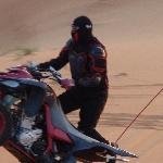rider performing stunts on desert bike