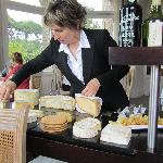 The frommagerie specialist dressing the cheeses at our table