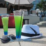 Margaritas at the infinity pool with my glasses and & hat