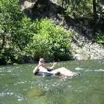 Greg - tubing down the river.