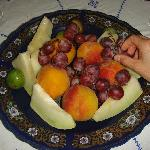 fruit plate of melon, peaches, fresh figs and grapes