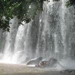 Bathing under the waterfall