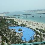 View over pool, the palm and Dubai skyline
