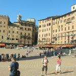 I'm standing in Il Campo - the main square of Siena.