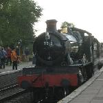 A steam engine pulls in