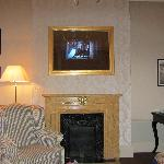 Tv in picture frame above fireplace