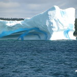 Big iceberg with blue stripe