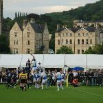 On-field action, with beautiful Bath in the background