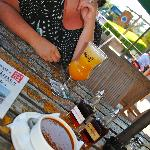 My wife with rum swizzle and Bermudian fish chowder