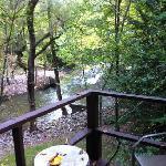deck overlooking waterfall/stream