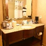 Large bathroom with plush towels and amenities galore.