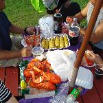 Making use of the picnic tables and grill. LOBSTER and Corn and the Cob!