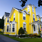 Sunshine Yellow House with White Trim