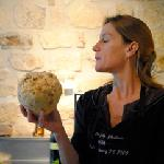 Charlotte in her kitchen with a celery root