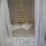 The curtained bed