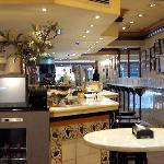 Tiled walls, marble bar and high tables