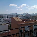 view across rooftops from balcony