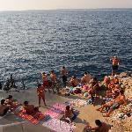 The free beach well rocks, at Grotta Azzurra