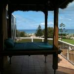 Day bed and view from front of house - the perfect spot to watch the sun set over the ocean!