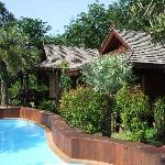 the lovely pool and bungalows