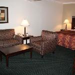 The area around the bed was large in the suite.