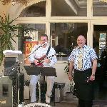 Jazz guitar musician & waiter in courtyard