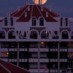 The setting of the full moon over Playa Las Americas