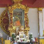 Front view of the shrine with the mummified monk, in the orange robes