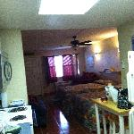 galley kitchen, full fridge, stove/oven, dishes