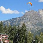 Paraglider coming over the top of the hotel