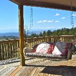 Our Favorite place to sit on their Great deck with views of the whole Sangre De Cristo range!