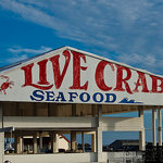 Main sign over the live crab and lobster area