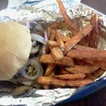 Half pound burger with onions, mushrooms, bacon and sweet potato fries