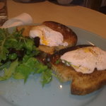 £5.75  TWO POACHED EGGS ON TOAST AND A DOZEN SALAD LEAF
