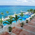 View from our balcony overlooking pristine pools and azure sea.