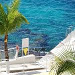 Resort steps lead to good snorkeling area with coral, fish and clear blue water.