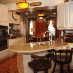 Enjoy a gourmet breakfast in the spacious, luxurious kitchen area