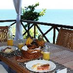 Breakfast on the veranda with a view of the beautiful Caribbean sea all around us